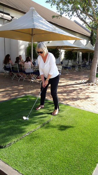 UK guests Christine and Henry Kordowicz visited Ernie Els's wine estate during a tour with Pietman in October. Here Christine tries out her golf swing on the range.