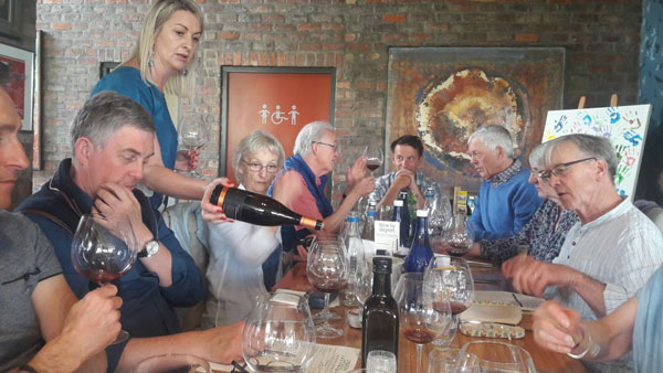 Enjoying Creation owner Carolyn Martin relating The Story of Creation during a seven course matched pairing are some of the 10 members of the Wiltshire wine club who enjoyed three days in the Winelands with Pietman and Andre in March.